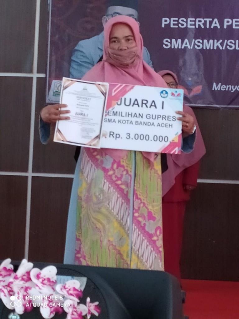 Sukmayati, M.Pd Juara I Pemilihan Gupres Tahun 2020 (Guru SMA Lab.Unsyiah)